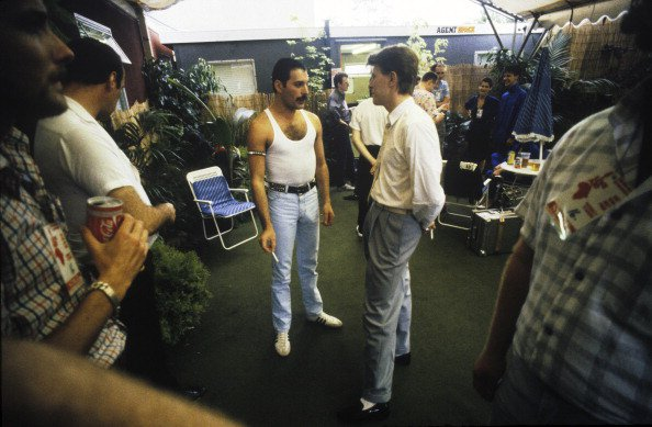 Queen singer Freddie Mercury and David Bowie talking backstage at the Live Aid concert, Wembley Stadium, London, 13th July 1985. (Photo by Denis O'Regan/Getty Images)